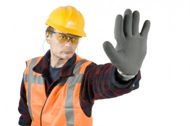 Ear plugs goggels and protective gloves giving a stop sign with his hand. Clipping Path included stock vector