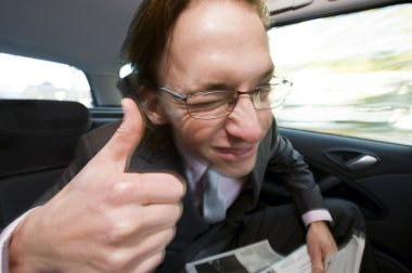Happy backseat passenger