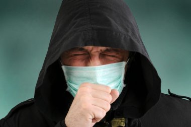 A man with a medical mask covering face, coughing. stock vector