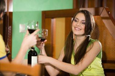 Boy and nice girl drink wine