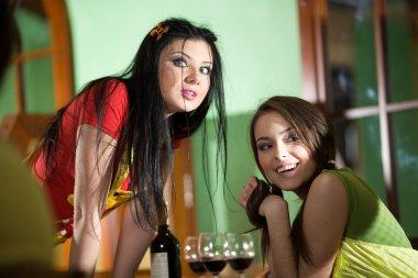 Girls are drinking wine
