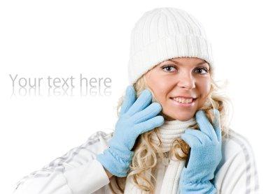 Winter beautiful girl in white hat