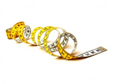 Measuring tape spiral isolated on a white background stock vector