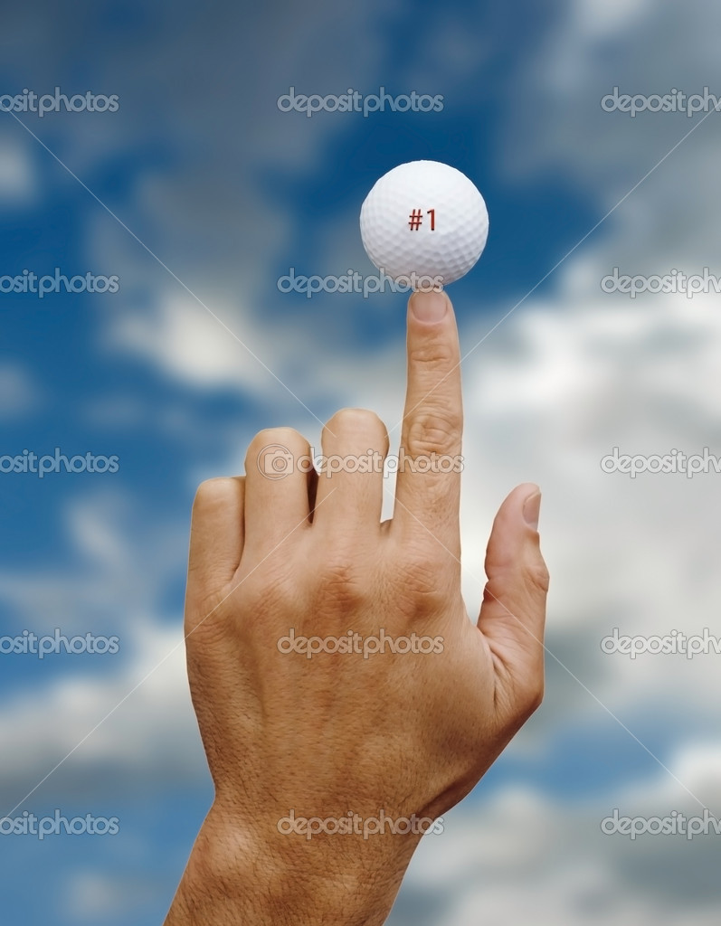 Man's hand balancing a golf ball on his index finger, #1 on ball in red