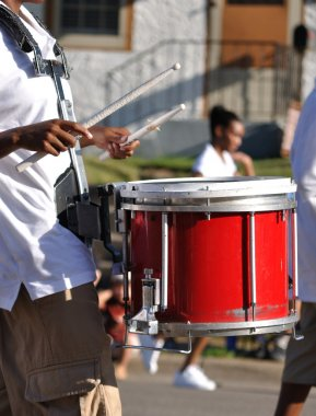 Drummer Playing Red Snare Drums