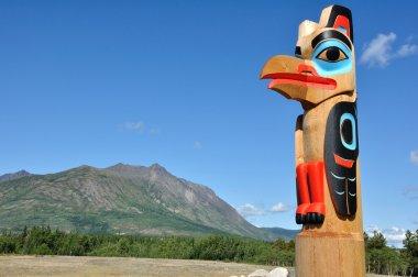 Eagle Totem Pole Against a Blue Sky