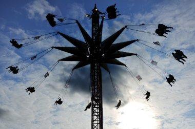 Silloutte of Carnival Swing Ride