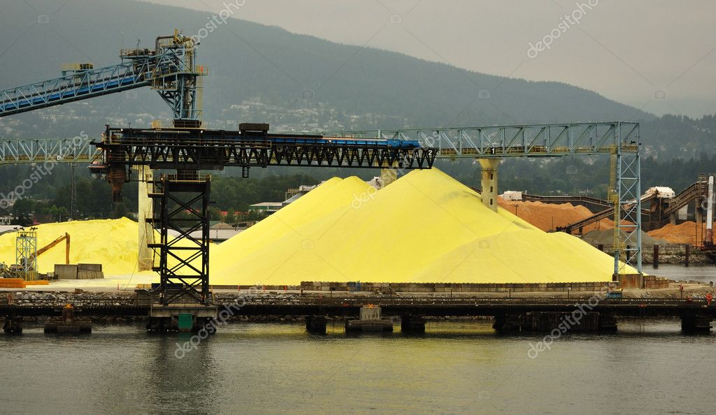 Piles of Yellow Sulphur on Dock of Chemical Processing Factory in Vancouver, British Columbia, Copy Space