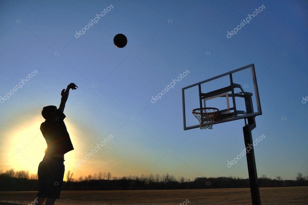 Silhouette of Teen Boy & Basketball