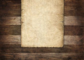 Vintage paper on wood