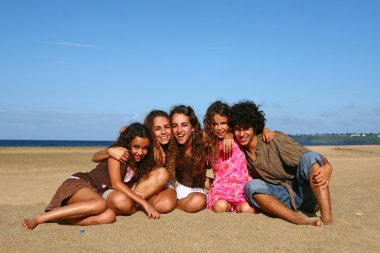 5 Siblings Smiling on the Beach