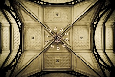 Ceiling of an old church, showing symmetric details. Sepia tones stock vector