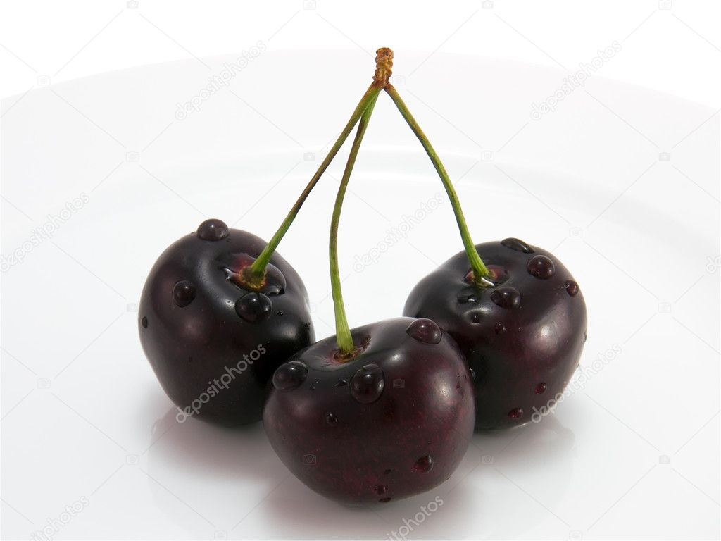 Black cherry on a plate close-up