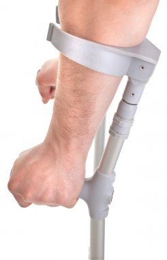 Hands holding crutch