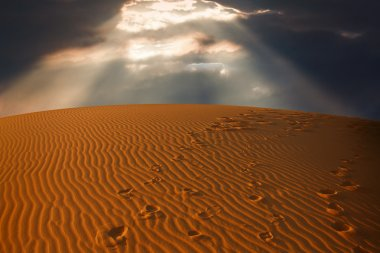 Sky split over the desert sand