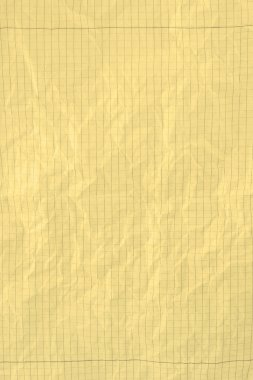 Yellow crumpled squared piece of paper