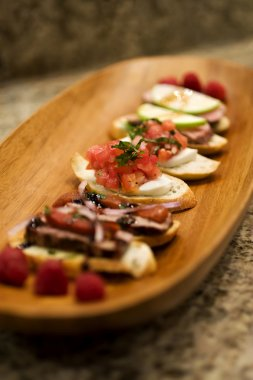 Bruchetta Appetizers on Wood Platter