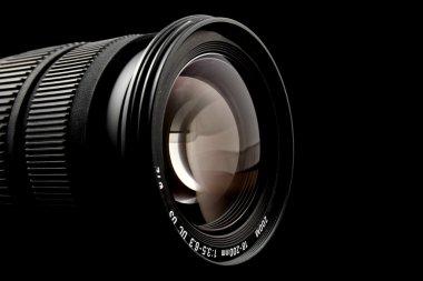 Closeup of camera lens over black background stock vector