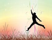 Giovane uomo che salta sul campo