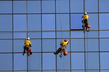 Men washing windows at height