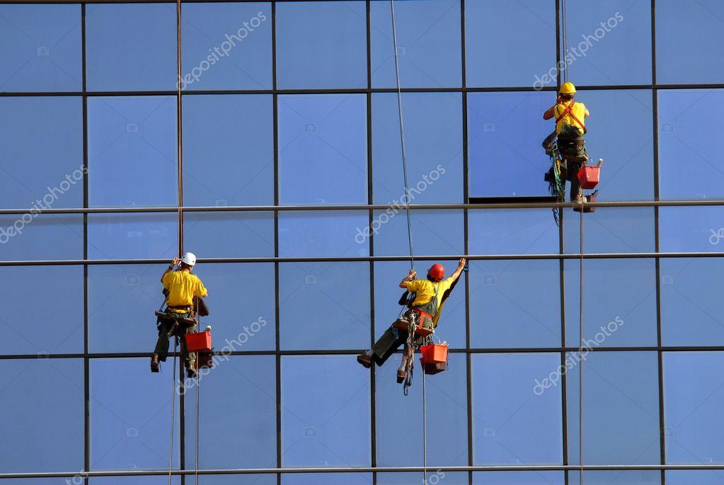 Men washing windows at height