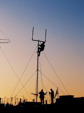 Workers repairing antenna