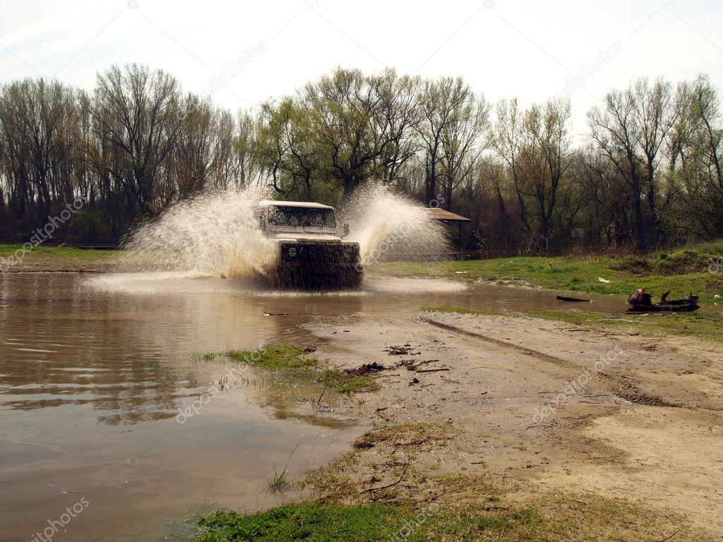 4x4 driving through river