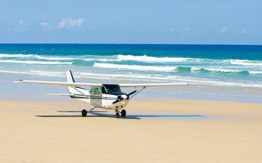 Light Aircraft Taking off on Beach