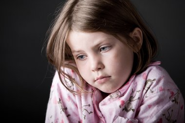 Shot of Young Child Looking Sad
