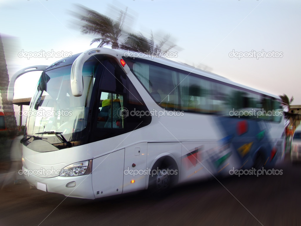 White coach with motion blur