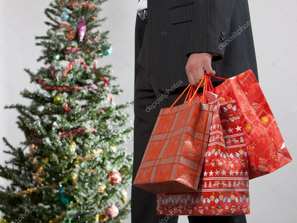 Business man with christmas presents