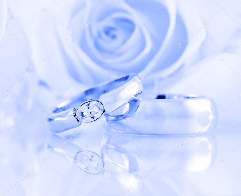Wedding still life with beautiful golden rings in blue tone
