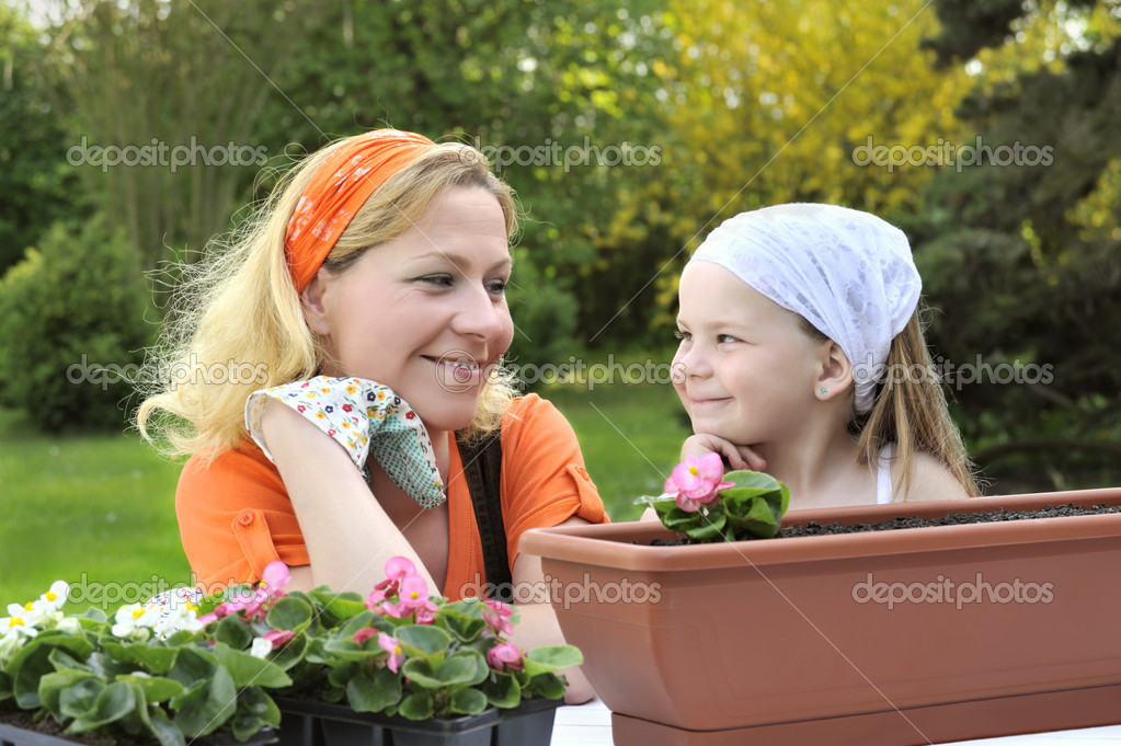Mother, daughter having gardening time