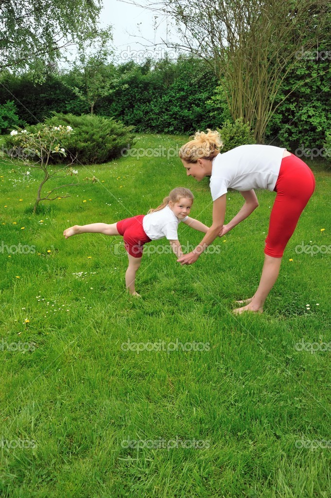 Young woman and daughter - practising