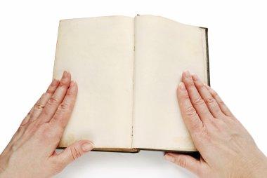 Hands on open empty book