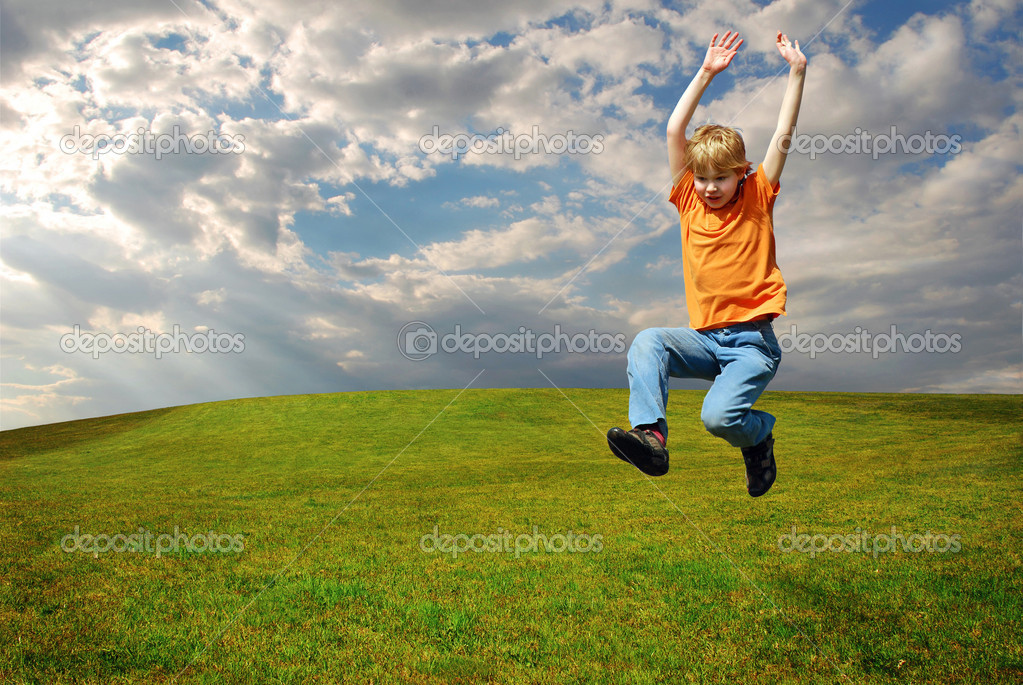 Boy jumping on grass