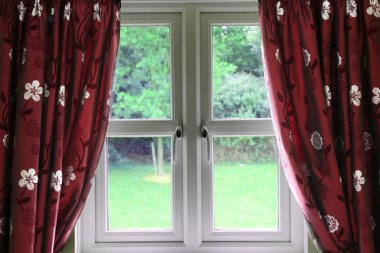 Window draped in curtains
