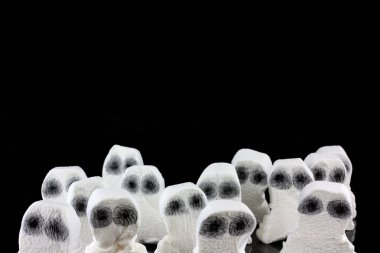 Ghost heads in a scary crowd