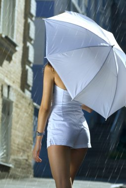 Back of woman with umbrella