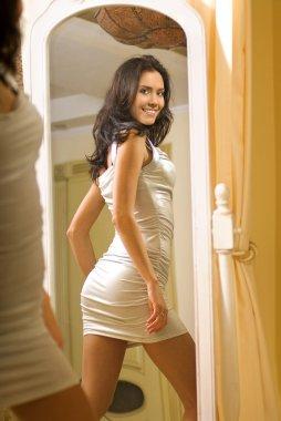 Girl near the mirror b