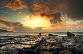 Fényképek naplemente a sziklás szigeten