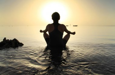 Meditation in Red Sea at sunrise