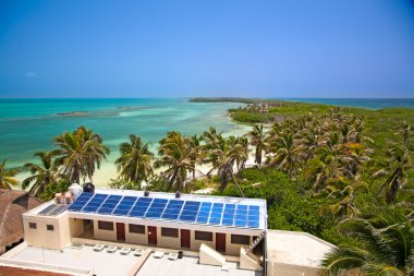 Beach with a building with a solar panel