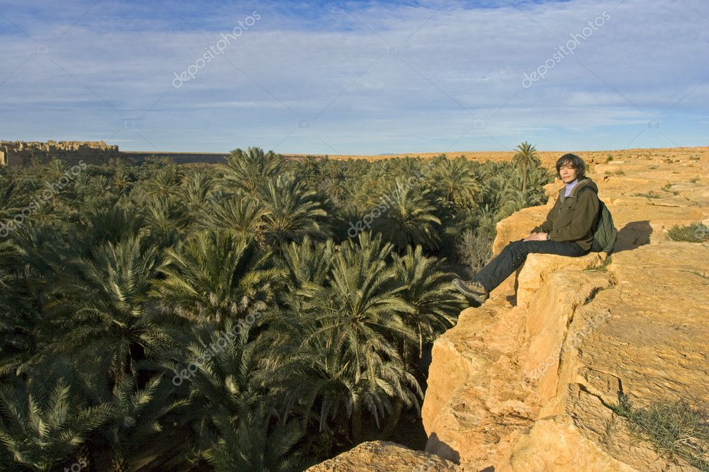 Girl above palm trees