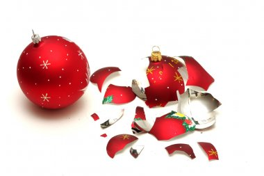 Broken red christmas ball and safe one