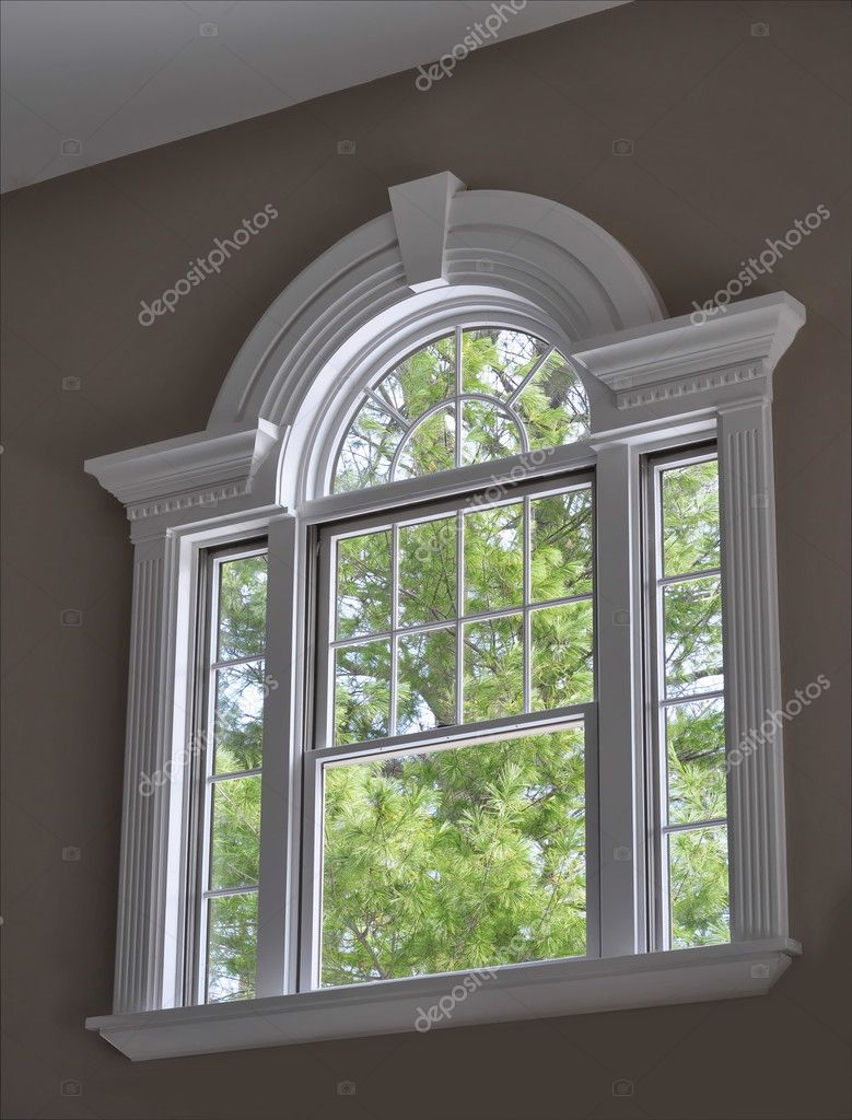 Arched window with crown molding stock photo kiyyah for Window design arch