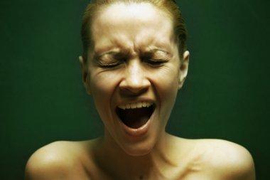 Great pain. Portrait of loud girl.