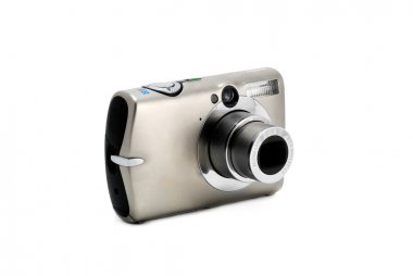Compact photo camera isolated over white