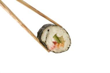 Chopsticks holding a Sushi roll