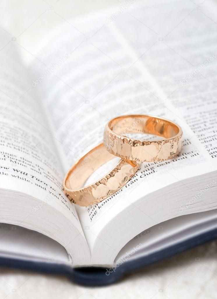 Wedding rings on a bible Stock Photo feferoni 2577479